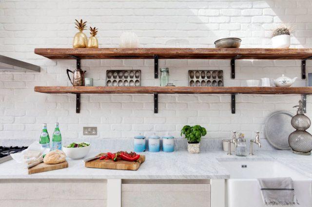 Dark open shelves in white kitchen interior design