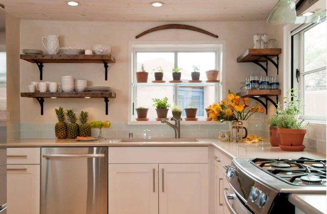 Open kitchen shelves next to the window