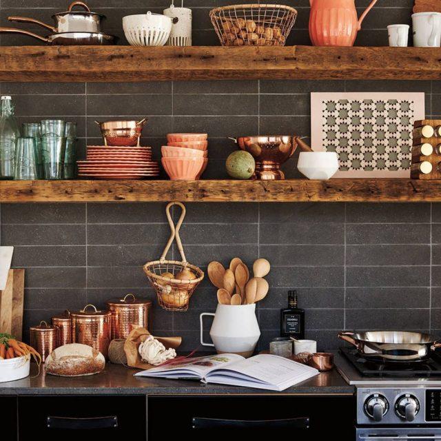 Open shelves in the dark kitchen
