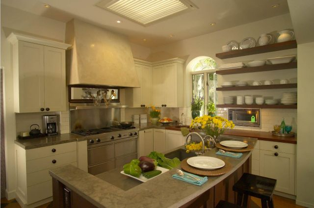 Open shelves in the kitchen for storing dishes and decor.