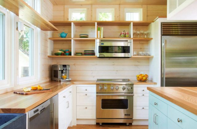 Open shelves in the small kitchen of a wooden country house