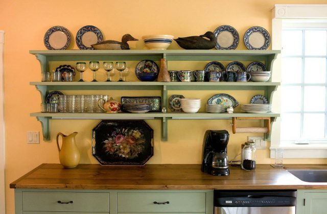 Open shelves of painted wood in the kitchen