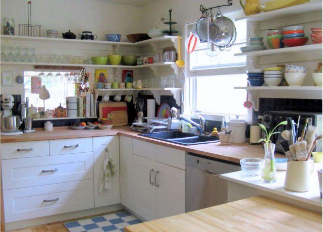 White floating corner open kitchen shelves