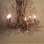 Eco-style chandelier made of wood branches