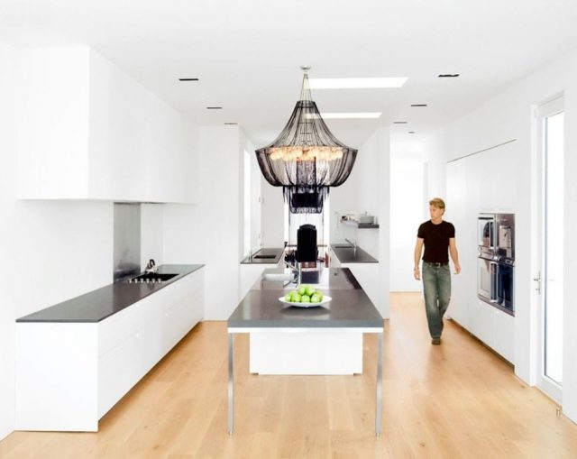 In This Progressive Kitchen, The Chandelier Makes The Design Very Unusual.