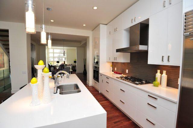 White kitchen with dark wooden floors