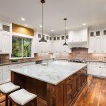 White Kitchen with Dark Island with cabinets