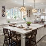 White kitchen island with seating and cabinets